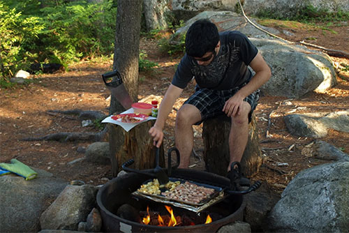 Breakfast cooking on the grill at Kettle Pond State Park (photo credit: Matt Parsons)