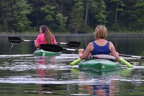 Kayakers at Lowell Lake State Park (photo credit: Linda Carlsen-Sperry)