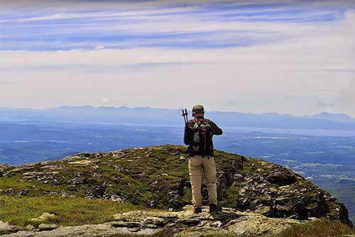 A hiker at the summit in Underhill State Park (photo credit: Summer Wuerthner)