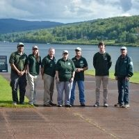Staff stand in front of Crystal Lake's waterfront