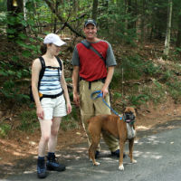 A couple walks a dog at Mt. Philo